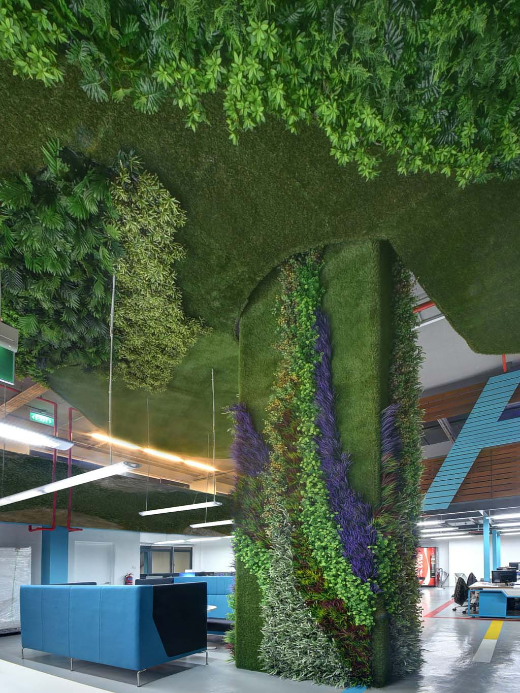 Artificial Grass And Plants Clad A Pillar And Ceiling In