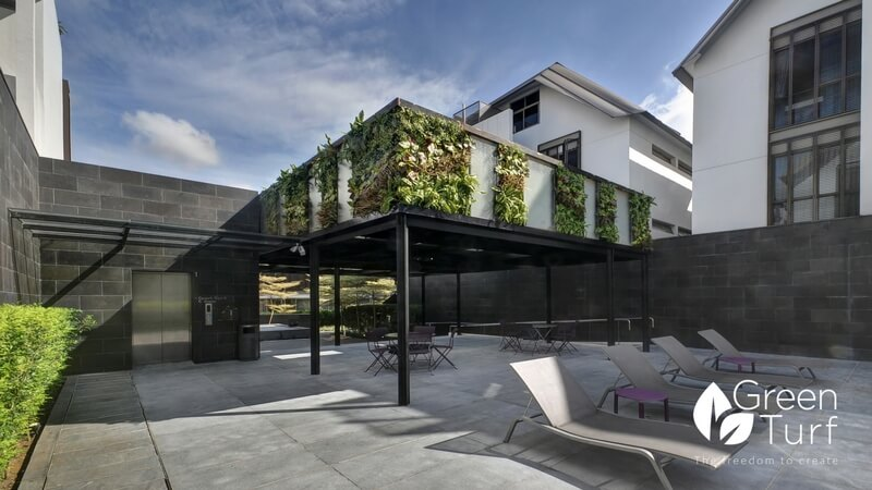 Clubhouse with Outdoor Artificial Green Wall Covering