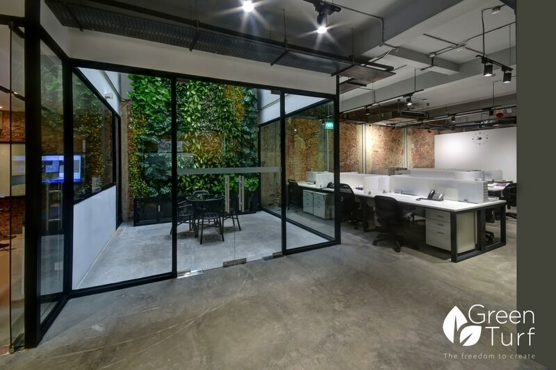Meeting Room in Air Well with Artificial Green Wall