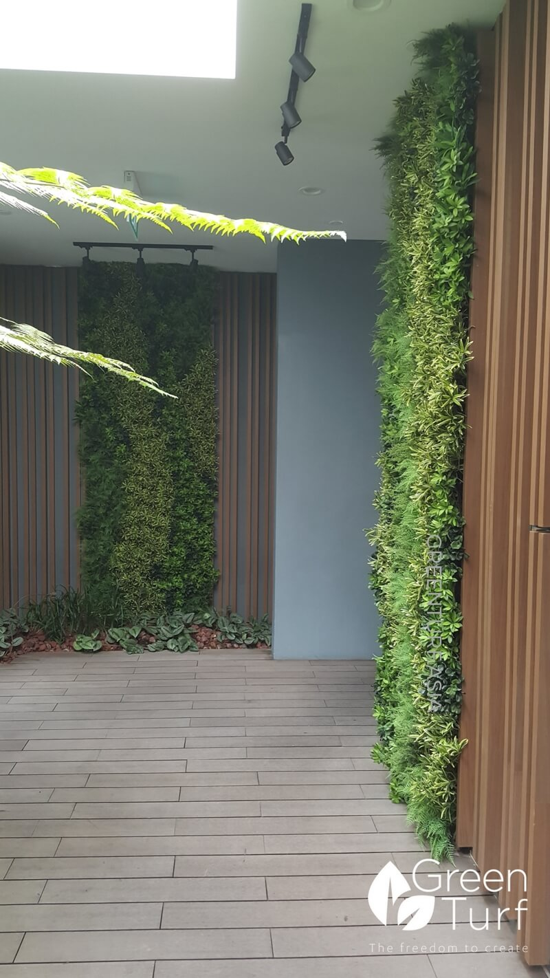 Artificial vertical garden and wooden strips feature wall